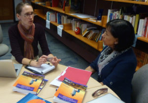 Kathryn Droske (French) and Mayra Taylor (Spanish) in discussion during a session.